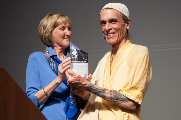 Peta's founder Ingrid Newkirk gives the Compassionate Action Award to Sharon Gannon & David Life, co-founders of Jivamukti Yoga