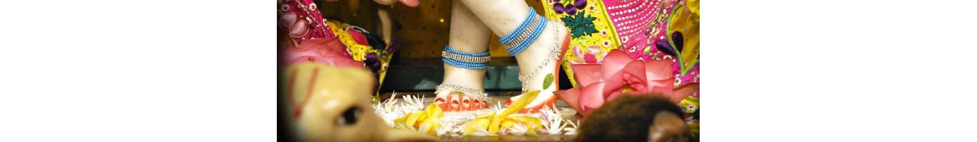 Manorama bowing to the lotus feet of the guru