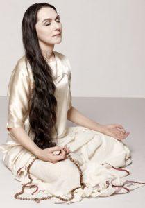 Sharon Gannon meditating with mala beads